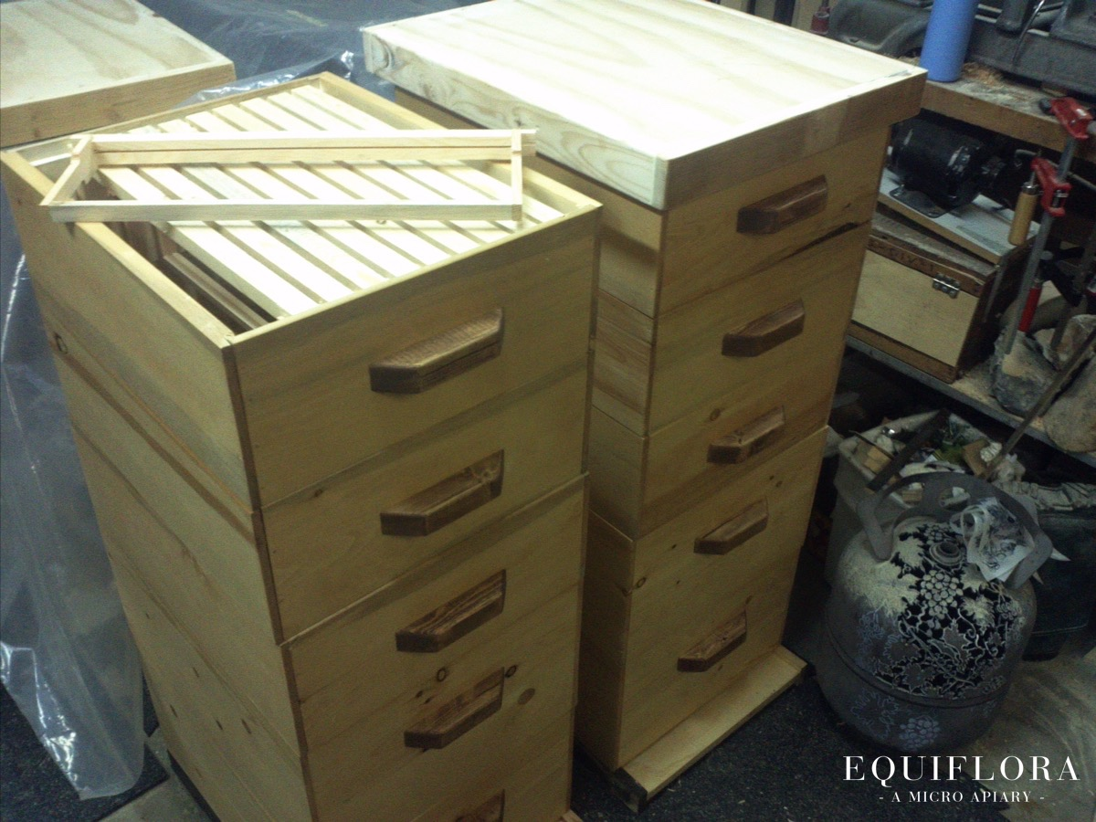 A set of brand new home made bee hives. Also in the photo is one of Jen's metal cuttings in PROGRESS, a rare site!